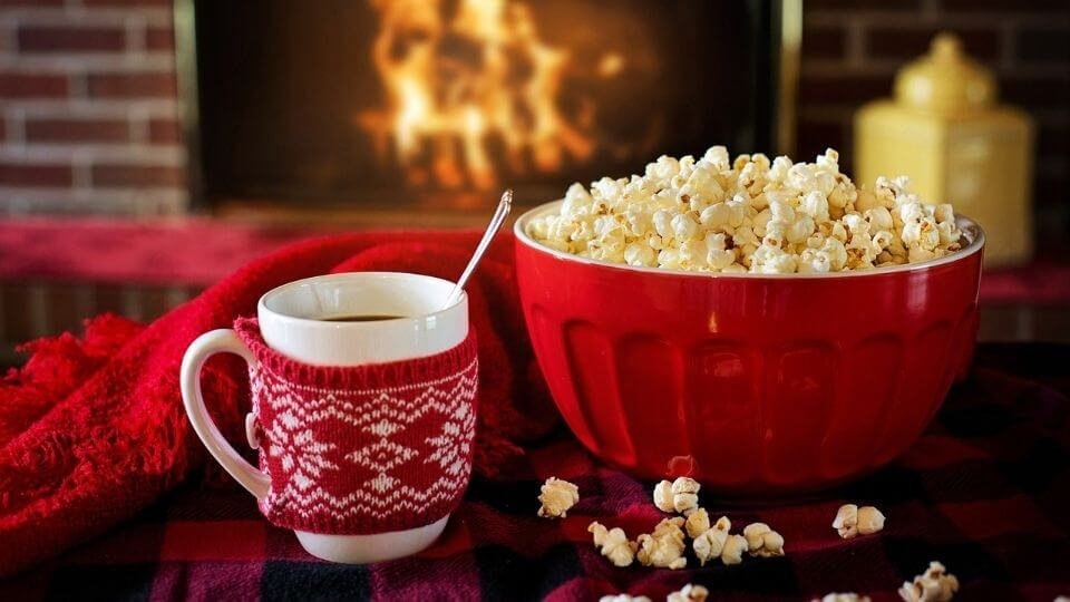 Christmas stress relief tips-fire, warm drink, popcorn bowl