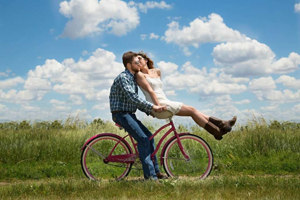 holistic health lifestyle - healthy relationships - man and woman on bike