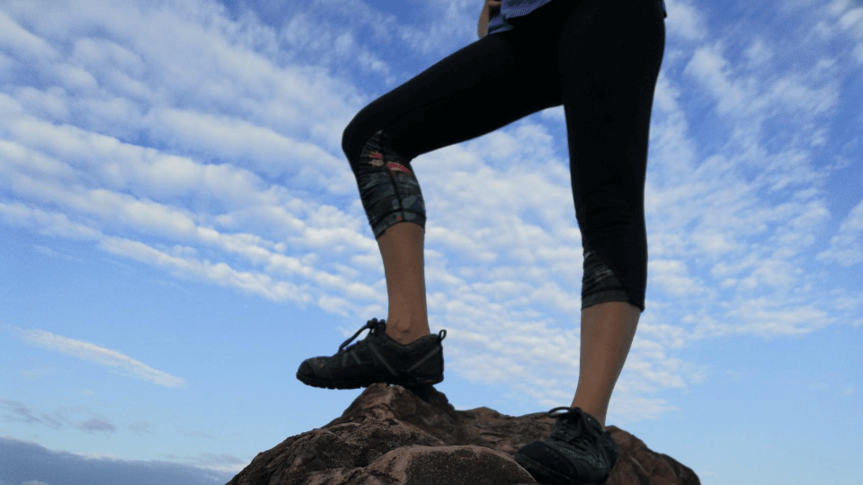 benefits of minimalist shoes-standing on Rock in Terraflex from Xero Shoes-Elly