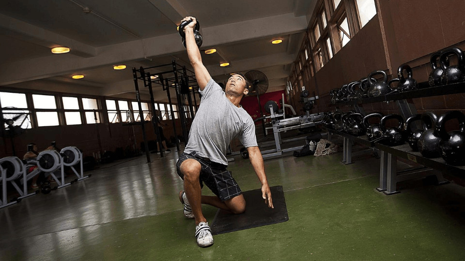 Fitness-motivation-tips-exercise-to-get-fit-man-lifting-kettle-bell-gym