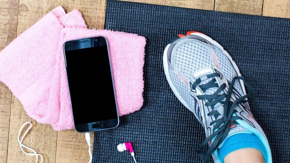 Beginners workout plan- shoes, mat, phone and towel