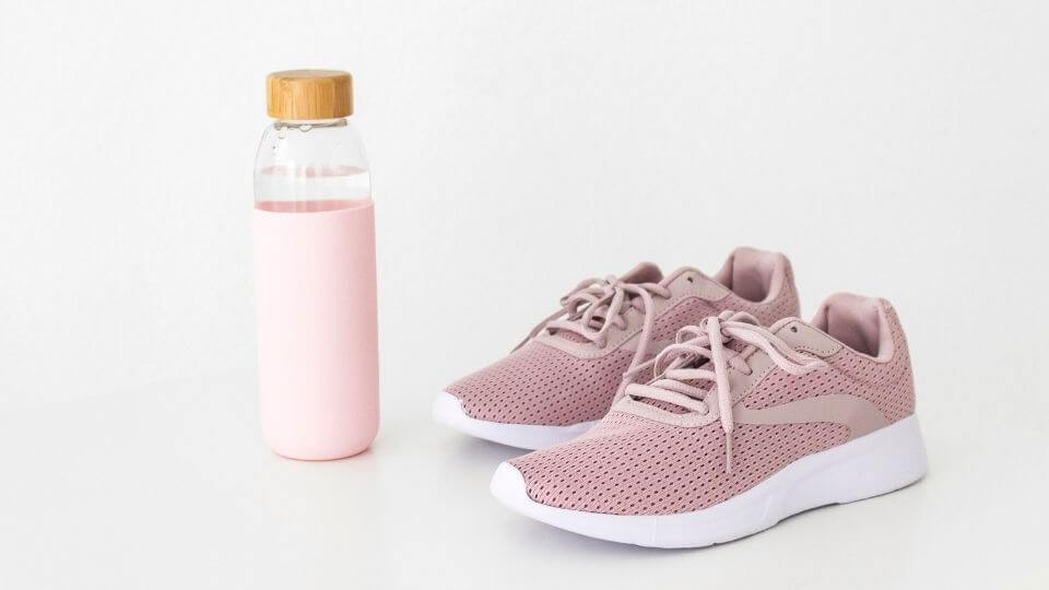 Beginners workout plan- sports shoes and drink bottle