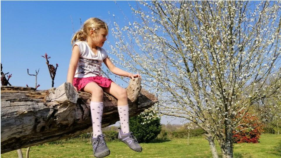 children's barefoot shoes-prio-xero shoes-Ayla sitting on a tree