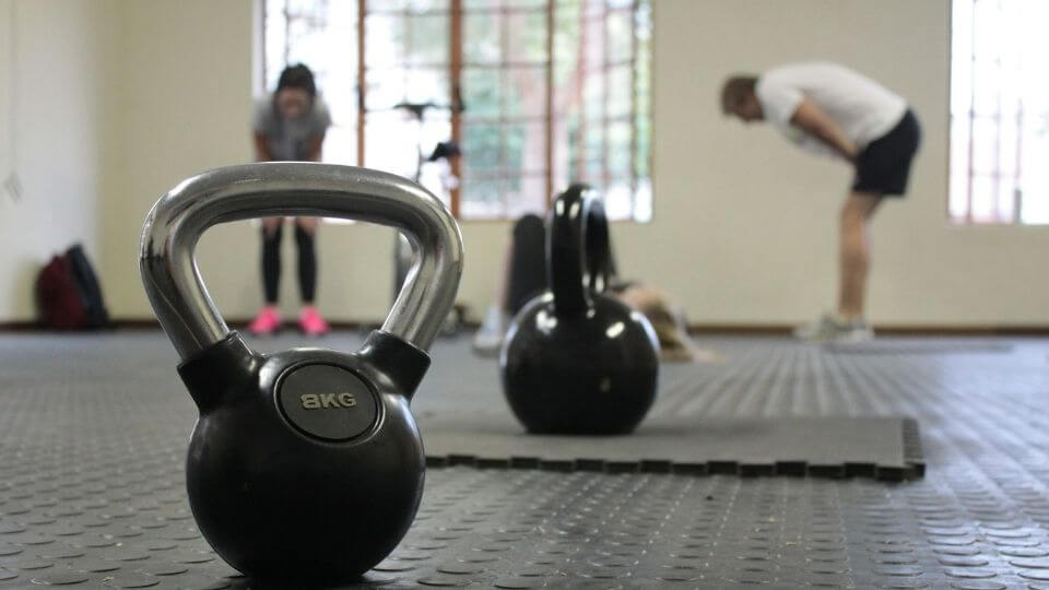 People doing kettle bell workout
