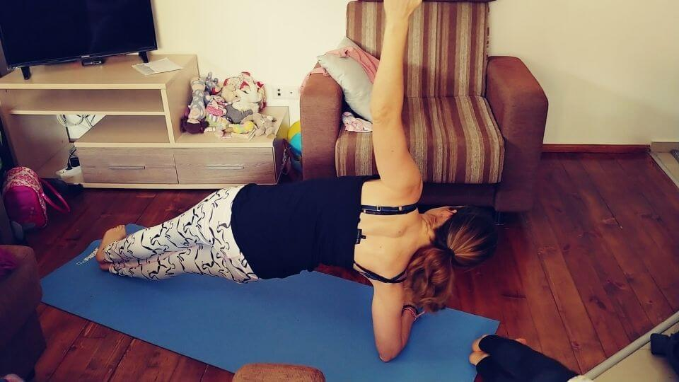 At Home workout routine-mid class side plank-Elly in living room