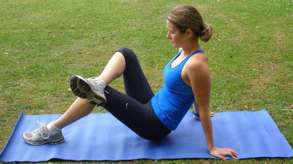 Best trigger point therapy tools-Elly using trigger point ball on glute muscle