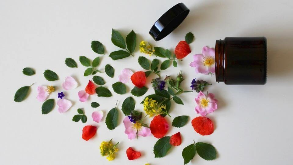 Reasons to see a naturopath - glass jar with petals spilling out