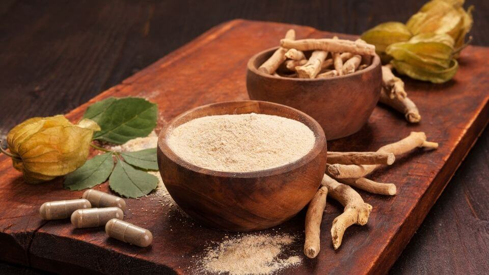 Health benefits of ashwagandha-root, powder and capsules on table