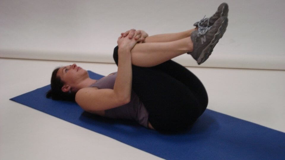 Yoga poses for digestion-Knees to Chest (Apanasana)