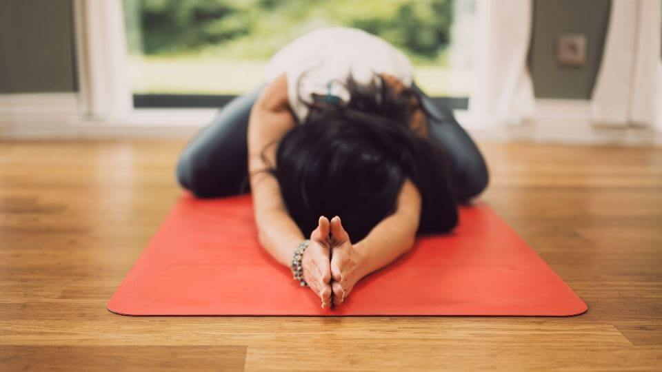 Yoga postures for digestion-wide legged child's pose